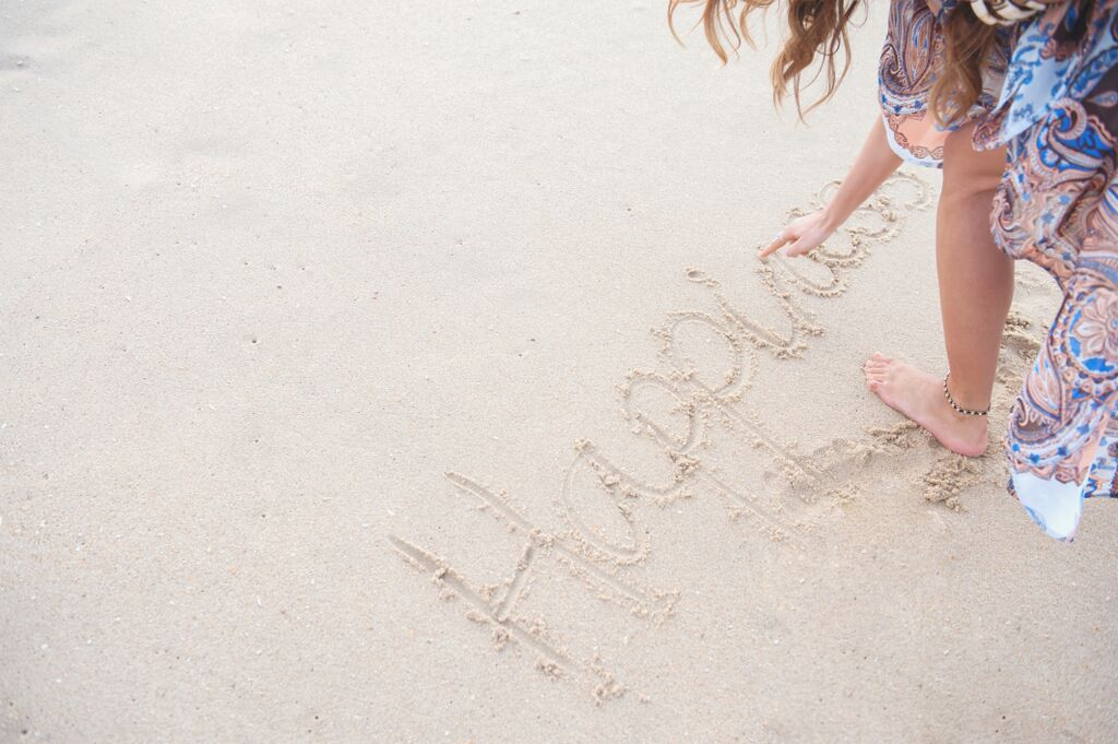 Happiness drawn in the sand